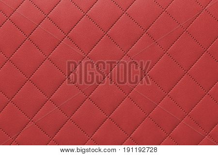detail of sewn leather red leather upholstery background pattern