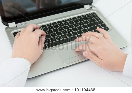 Hands of an office woman typing. view from above.