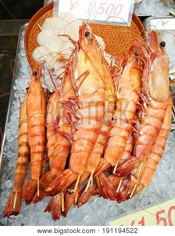 Grilled giant prawns are sold in the seafood market. Osaka, Japan (Price 1,500 yen per piece)