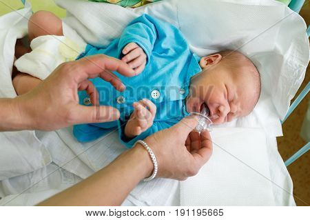 Crying Newborn Baby Infant In The Hospital