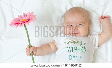 Baby Girl Holding A Flower