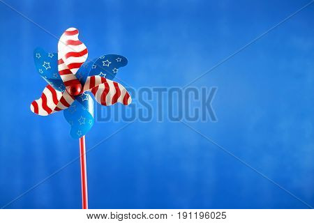 An American holiday pinwheel on blue background