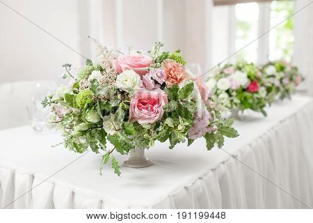 table setting, festive tables ready for guests. Beautifully organized event. floral arrangement, fresh flowers cut-off