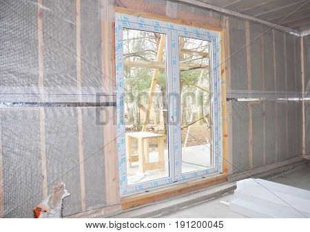 KIEV - UKRAINE JUNE - 19 2017: House wall insulation. Solid mineral wool wall insulation. Wall insulation for energy saving. House wall heat insulation with mineral wool building under construction.