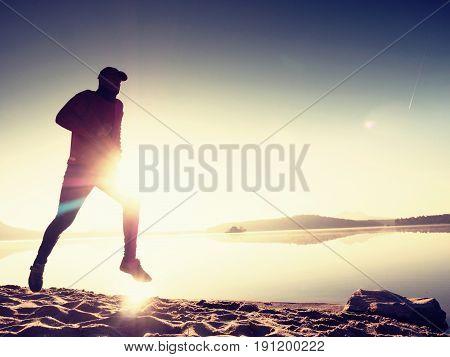 Slim Young Fitness Man Runner On Beach, Tropical Trail Runner.  Cheerful Sportsman Run On Beach