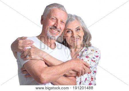 Studio portrait of happy senior couple isolated on white background