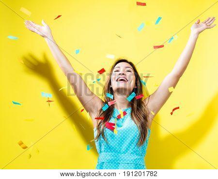 Happy Woman Celebrating With Confetti