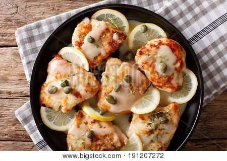 Italian Chicken Piccata With Sauce, Lemon And Capers Close-up On A Plate. Horizontal Top View
