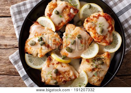 Italian Food: Chicken Piccata With Sauce, Lemon And Capers Close-up. Horizontal Top View