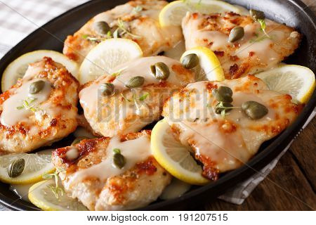 Italian Chicken Piccata With Sauce, Lemon And Capers Close-up. Horizontal