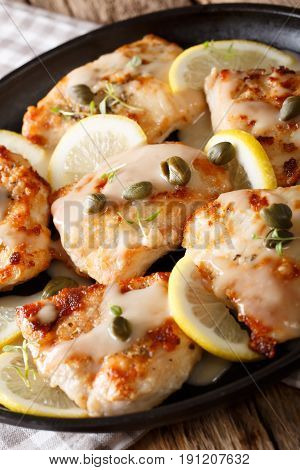 Italian Chicken Piccata With Sauce, Lemon And Capers Close-up. Vertical