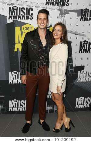 NASHVILLE, TN-JUN 07: Russell Dickerson (L) and Kailey Dickerson attend the 2017 CMT Music Awards at the Music City Center on June 7, 2017 in Nashville, Tennessee.