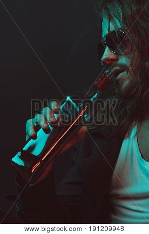 Young Caucasian Drunkard In Sunglasses Drinking Whiskey From Bottle