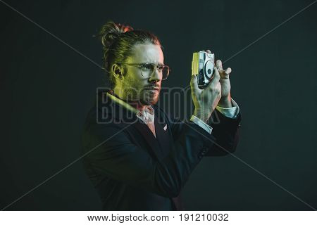 Young Caucasian Man In Tuxedo Taking Photo On Point-and-shoot Camera