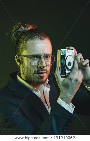 Young Stylish Man Taking Photo On Point-and-shoot Camera
