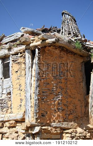 Popular architecture in Soria, Spain, Calatañazor, facades of branches with mud, adobe,