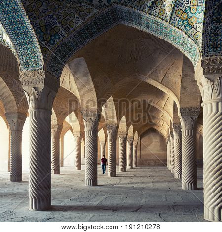 SHIRAZ IRAN - SEPTEMBER 16 2014: A man passing through Shabestan of Vakil Mosque. This religious place was built between 1751 and 1773 during reign of the Zand dynasty all over Iran.