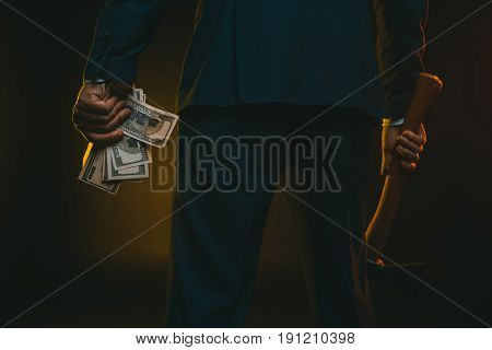 Cropped Shot Of Man In Suit Holding Ax And Us Dollar Banknotes