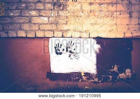 Brown Handprint On White