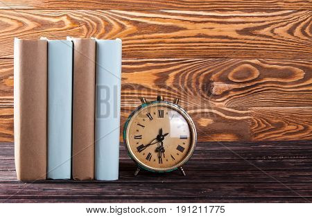 Old Clock And Stack Of Old Books