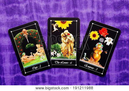 Tarot readings with deck of Tarot cards - purple cloth background