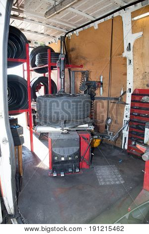 Equipment And The Machine To Change A Car Tire In A Truck