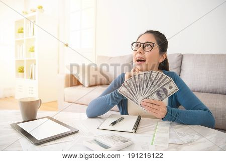 Excited Student Holding Money Dollar