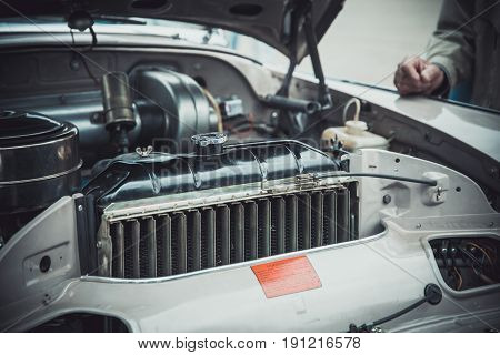 Engine and other details of the classic retro car at the exhibition of vintage cars
