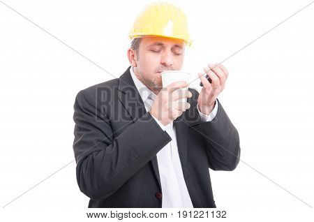 Contractor Smelling Takeaway Coffee Wearing Hardhat