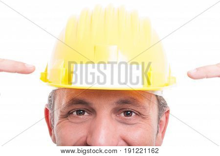 Close-up Of Foreman Wearing Hardhat Pointing Business Card