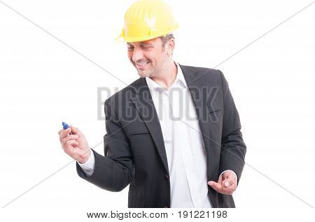 Portrait Of Architect Wearing Hardhat Writing With Marker