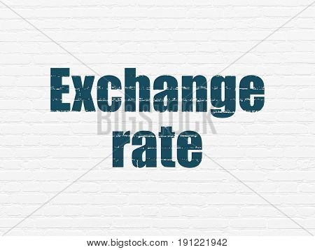 Money concept: Painted blue text Exchange Rate on White Brick wall background