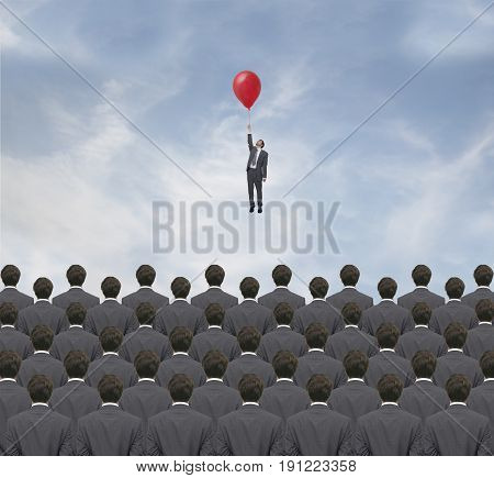 Businessman flying over a group of businessmen