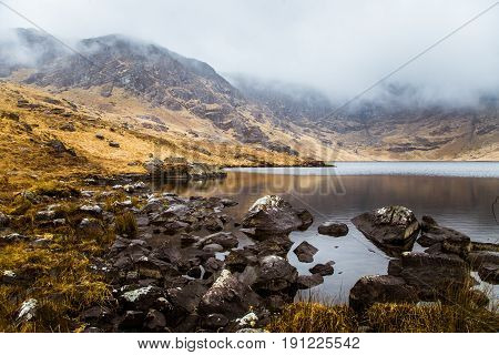 A Beautiful Irish Mountain Landscape With A Lake In Spring. Gleninchaquin Park In Ireland.
