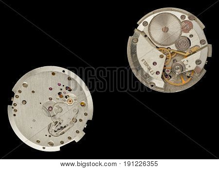 An old clockwork - right and underside.