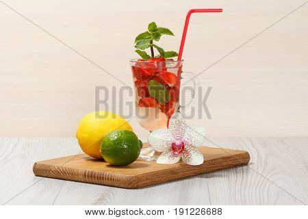 Carbonated Lemonade With Strawberry Slices And Mint On An Wooden Cutting Board
