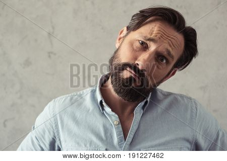 Portrait Of Upset Middle Aged Man Looking At Camera