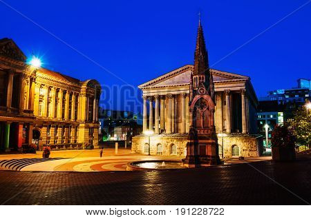 Birmingham UK. Chamberlain square at night with illuminated Town Hall and Chamberlain Memorial before the major demolition and reconstruction. Clear blue sky