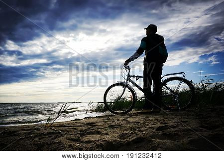Young Man Cyclist Standing Next To Bike