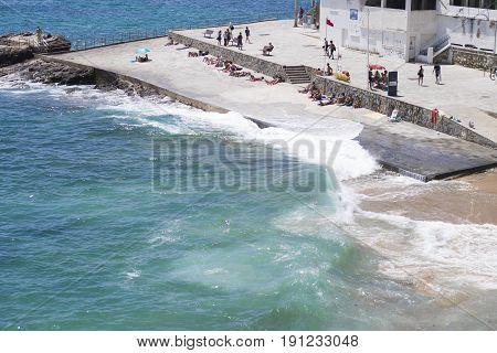 Praia da Azarujinha, beach in Estoril, portugal summer