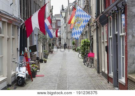 Street with flags in Delft in the Netherlands