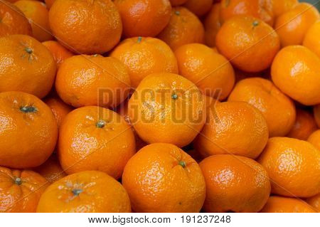 Fresh Mandarin Oranges Texture. Mandarin For Sale On Market. Agriculture Background. Close-up. Top V