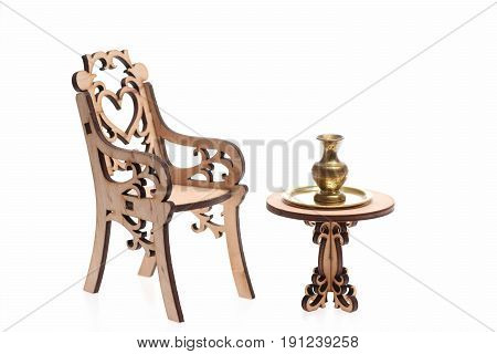 vase on golden tray on decorative wooden table with engraved chair isolated on white background. Antique concept copy space