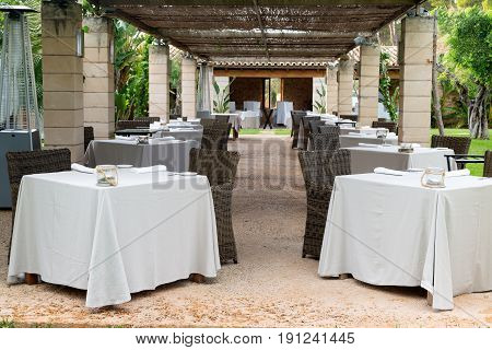restaurant on the lawn with columns table, garden