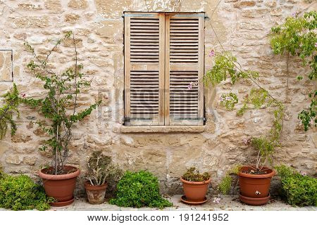 Window with wooden shutters in an old building