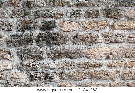 Background sand stone textured wall close-up architecture