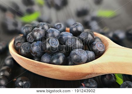 blue bilberry on a black old table