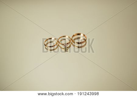 Wedding rings of the newlyweds on the mirror. Engagement gold rings. Wedding in Montenegro.