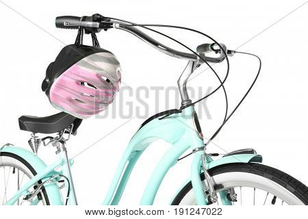 Modern two-wheeled bicycle with helmet on white background