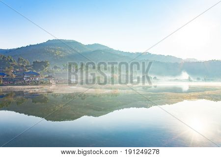 Landscape photo of morning with white fog over lake at Rak Thai village,Pang Oung, MaeHongSon Thailand.
